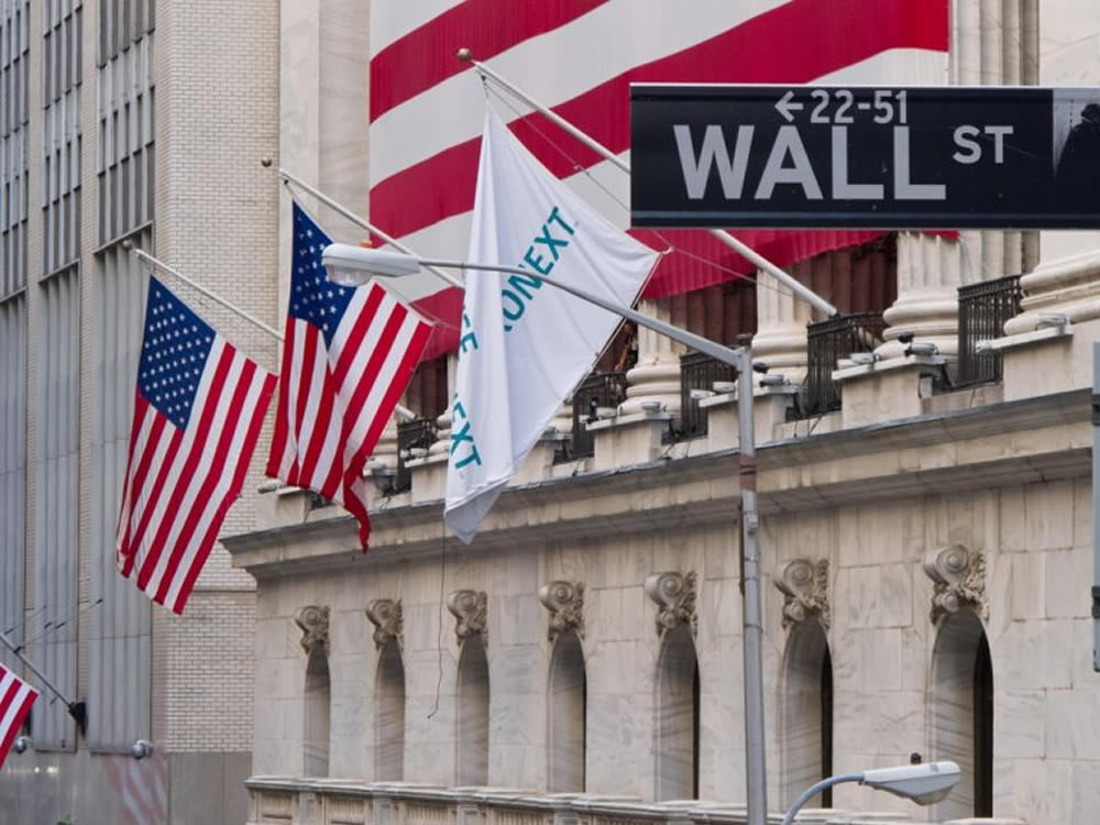 Flags flying on Wall Street with stocks at market highs