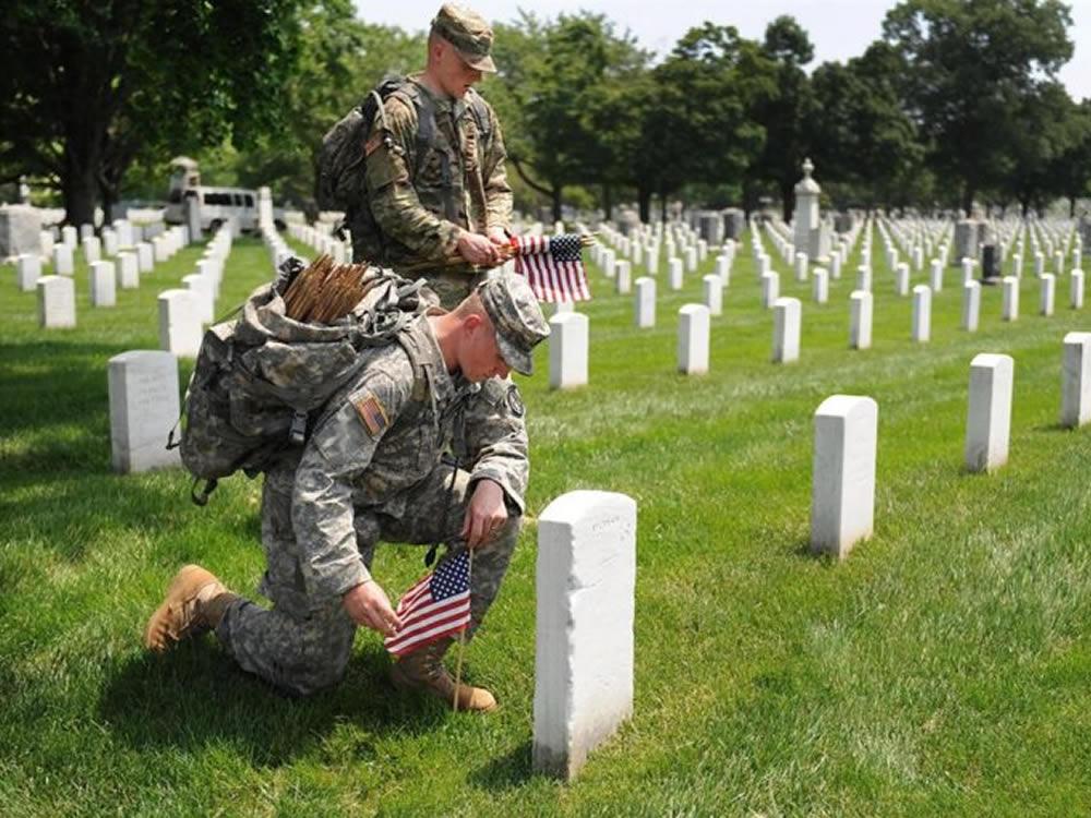 Post-9/11 GI solders setting flags at Arlington National Cemetery