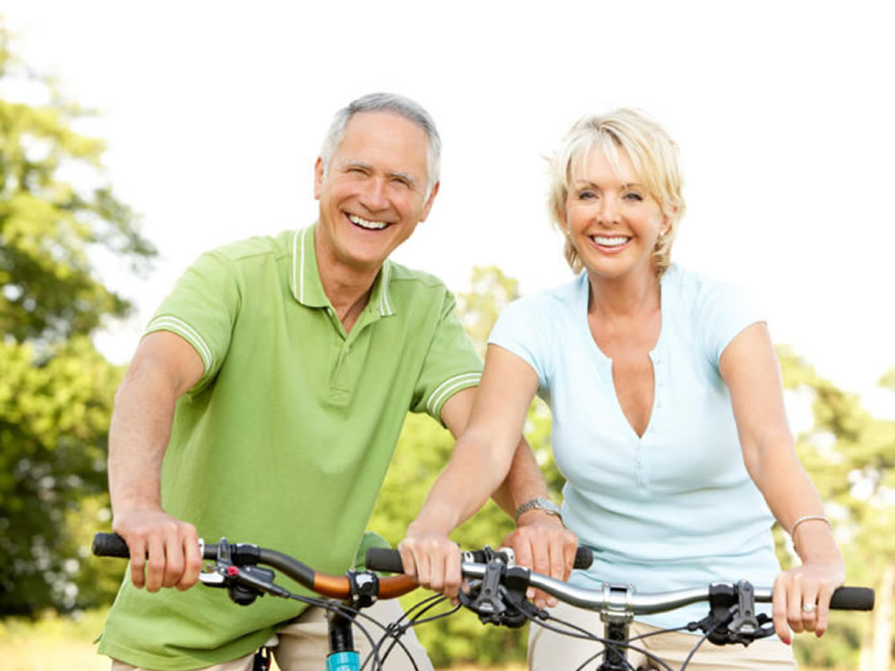Older couple biking know to avoid these top 10 retirement myths