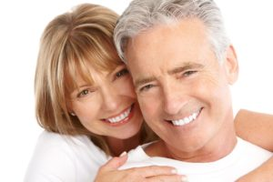 Older couple on white background, happy following financial planning near retirement