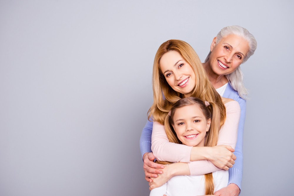 Three generations of women, representing the Sandwich Generation