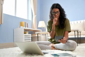 Young woman thinking about why you need a financial advisor