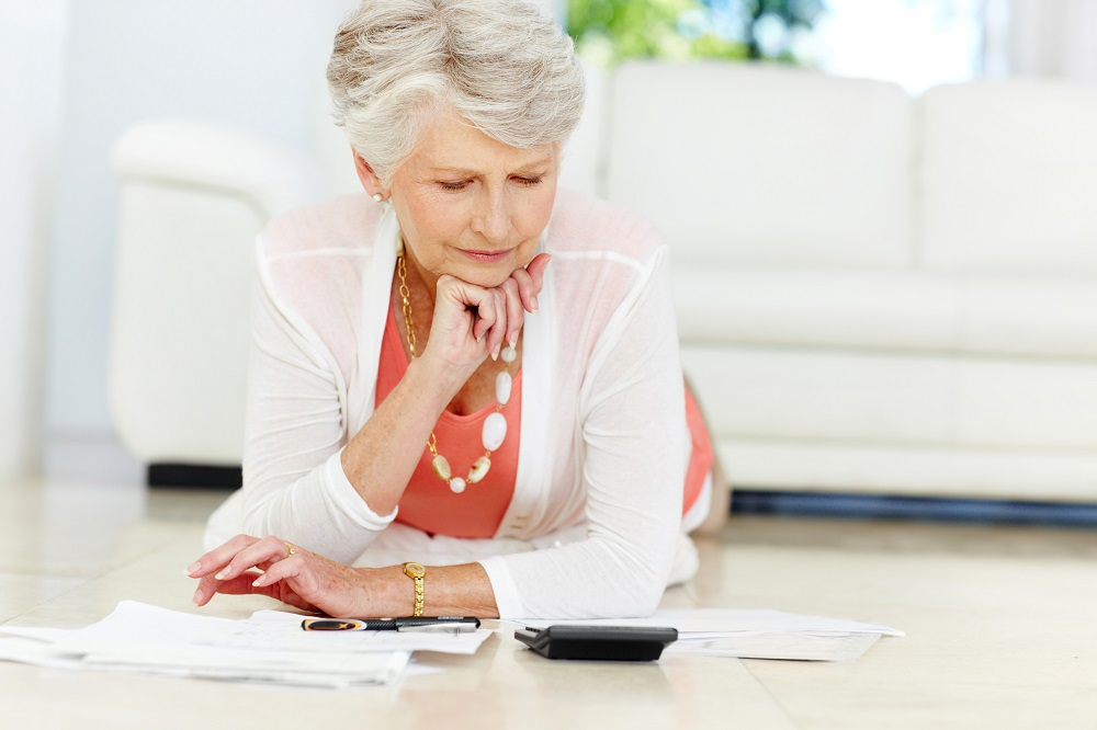 Older woman considering what you need to know now about your taxes