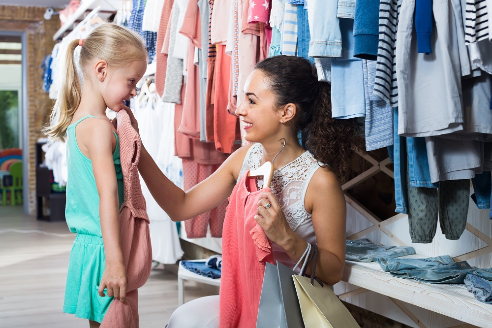 Mom and daughter using school shopping as part of financial education